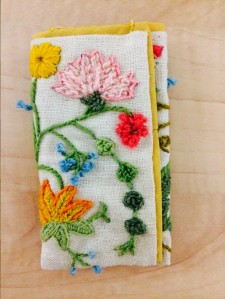 Crewel stitching by Constance Eliassen turned into a pouch by daughter Meredith